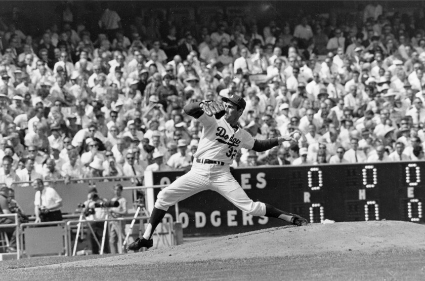 Dodgers starter Sandy Koufax pitches against the Baltimore Orioles in Game 2 of the 1966 World Series.