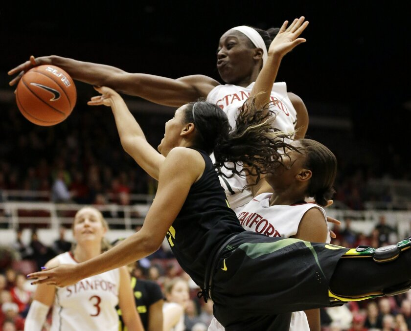 Stanford 's Chiney Ogwumike, top, blocks a layup-attempt from Oregon's Lexi Petersen during the first half of an NCAA college basketball game on Friday, Jan. 3, 2014, in Stanford, Calif. (AP Photo/Marcio Jose Sanchez)