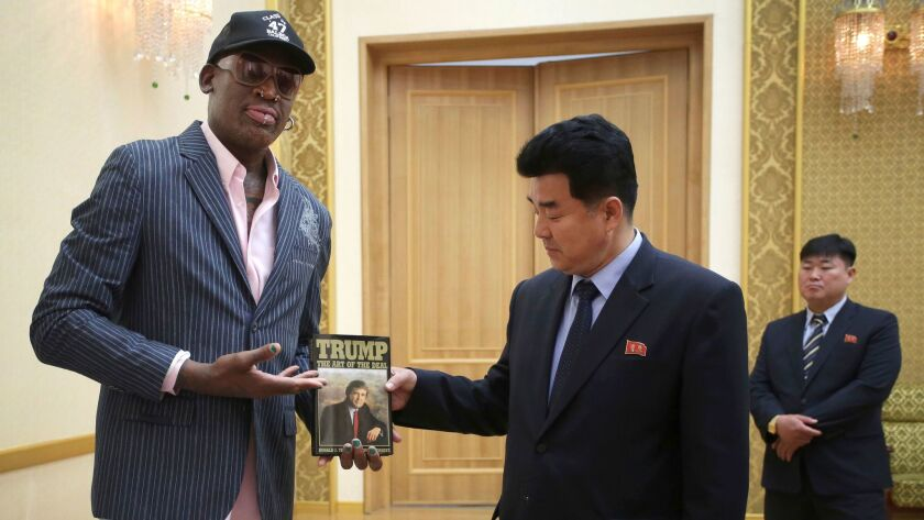 """Former NBA basketball star Dennis Rodman presents a book titled """"Trump The Art of the Deal"""" to North"""