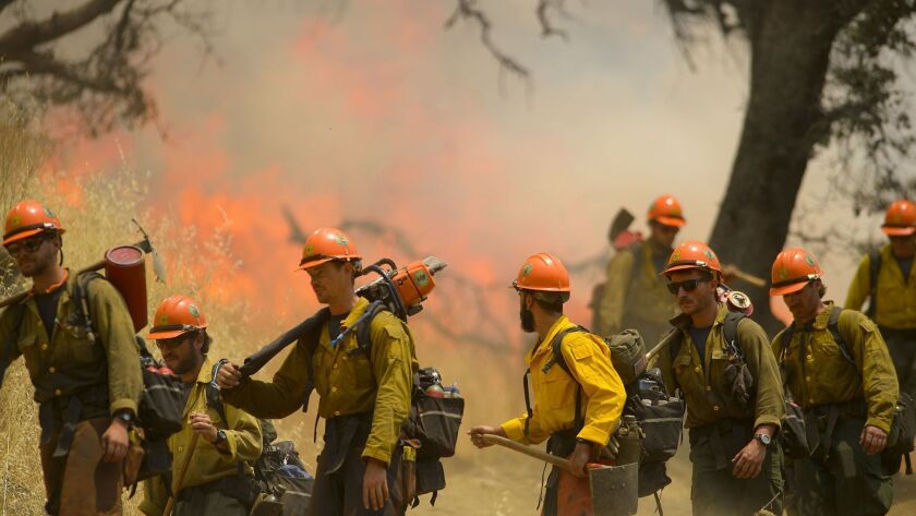 """""""Hot shot"""" crews from Mendocino use backfires to help contain the County fire along Highway 129 near Lake Berryessa in Yolo County on July 3."""