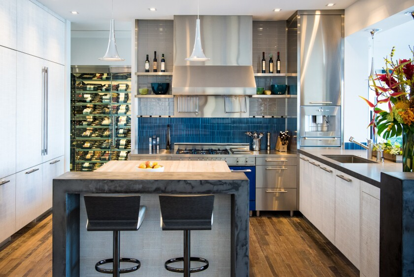 Today, he loves to entertain, which is no surprise, given that his kitchen looks like this. That gorgeous wine rack? It used to be the closet that was tucked underneath the staircase.