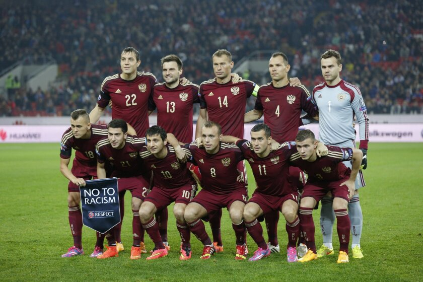 FILE - In this Sunday, Oct. 12, 2014 file photo, Russia's team players pose for a photo before an Euro 2016 Group G qualifying round soccer match between Russia and Moldova at the Otkrytie Arena of Spartak Moscow soccer club in Moscow. The European Championship has a reputation for being the soccer