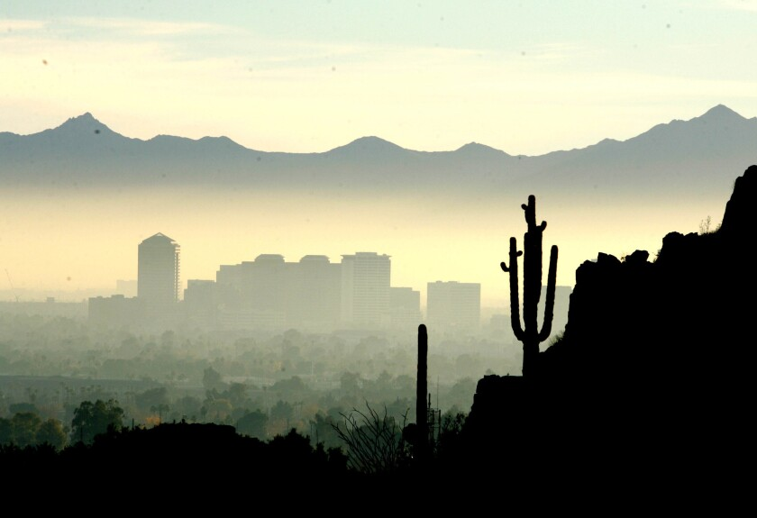 Smog and dust color the Phoenix skyline.