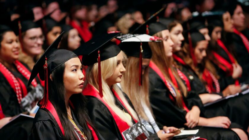 Degree candidates in the College of Arts and Letters at San Diego State University listen during the 108th Commencement Ceremony, held inside Viejas Arena in May 2017.