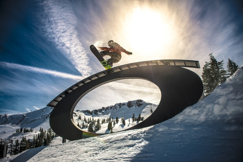 Snowboarding at Squaw Valley Alpine Meadows in Olympic Valley, Calif.