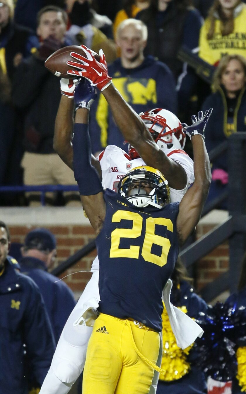 Michigan's Jourdan Lewis (26) breaks up a pass intended for Rutgers' Carlton Agudosi during the second half of an NCAA college football game Saturday, Nov. 7, 2015, in Ann Arbor, Mich. Michigan defeated Rutgers 49-16. (AP Photo/Duane Burleson)