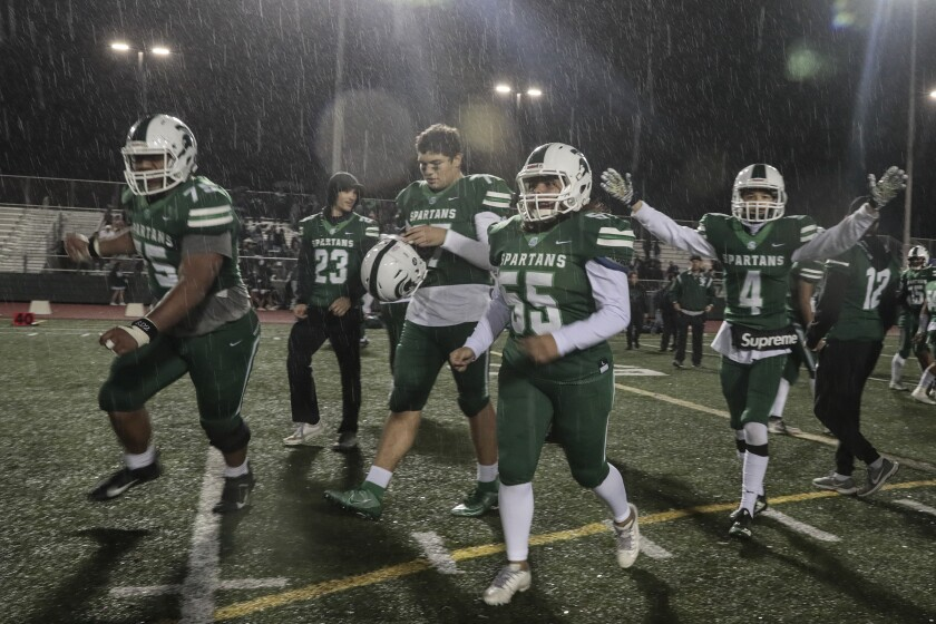 South Torrance players celebrate their 47-28 win over Canoga Park on Dec. 6, 2019.