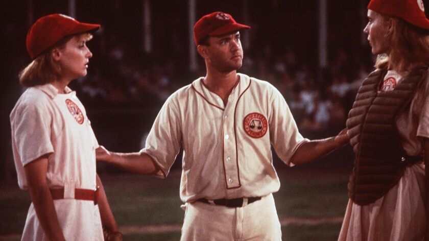 """Lori Petty (left), Tom Hanks (center) and Geena Davis (right) star in """"A League of Their Own."""""""