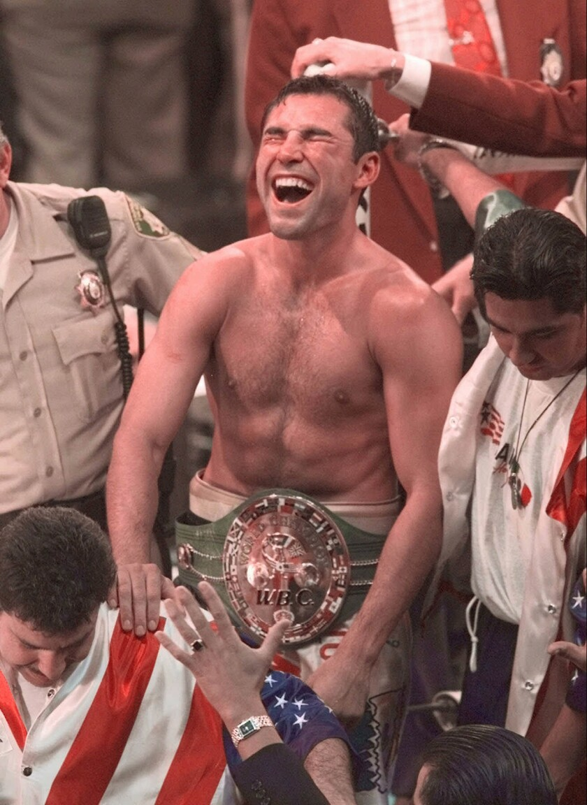 Oscar De La Hoya celebrates his win over Julio Cesar Chavez