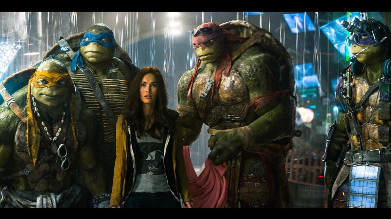 "From left: Michelangelo, Leonardo, Megan Fox (as April O'Neil), Raphael and Donatello in a scene from ""Teenage Mutant Ninja Turtles."""