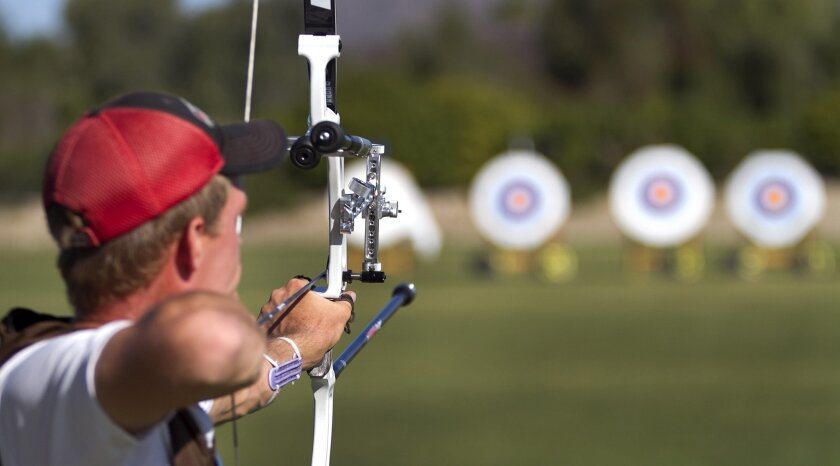 Jacob Wukie aims his bow downfield during a practice at the Olympic Training Center in Chula Vista. Wukie was an alternate in the 2008 Summer Olympics and is hoping to be selected for the 2012 Summer Olympics in London. Selection trials for archery will be held at the end of April.
