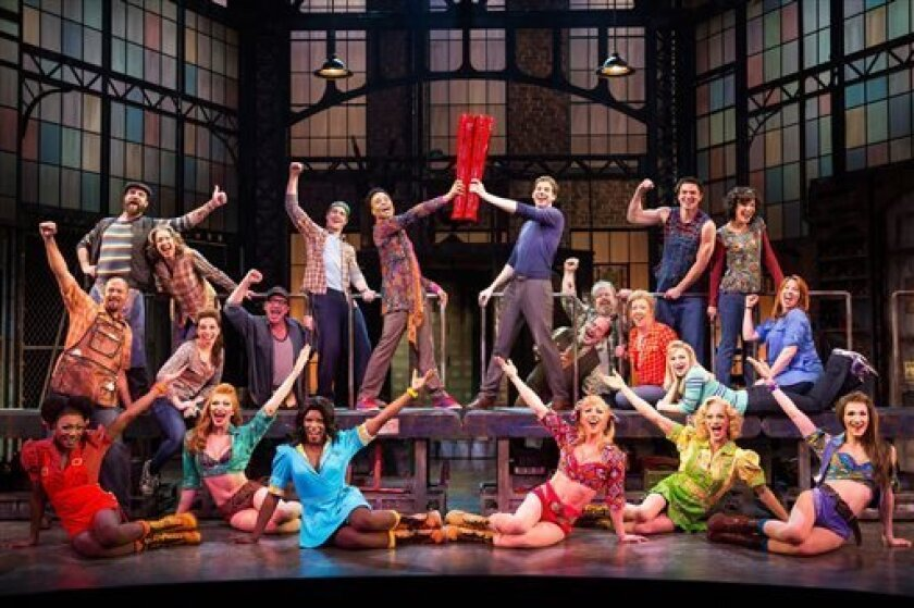 "This theater image released by The O+M Company shows the cast during a performance of the musical ""Kinky Boots.""  The Cyndi Lauper-scored ""Kinky Boots,"" based on the 2005 British movie about a real-life shoe factory that struggles until it finds new life in fetish footwear, is nominated for 13 Tony"