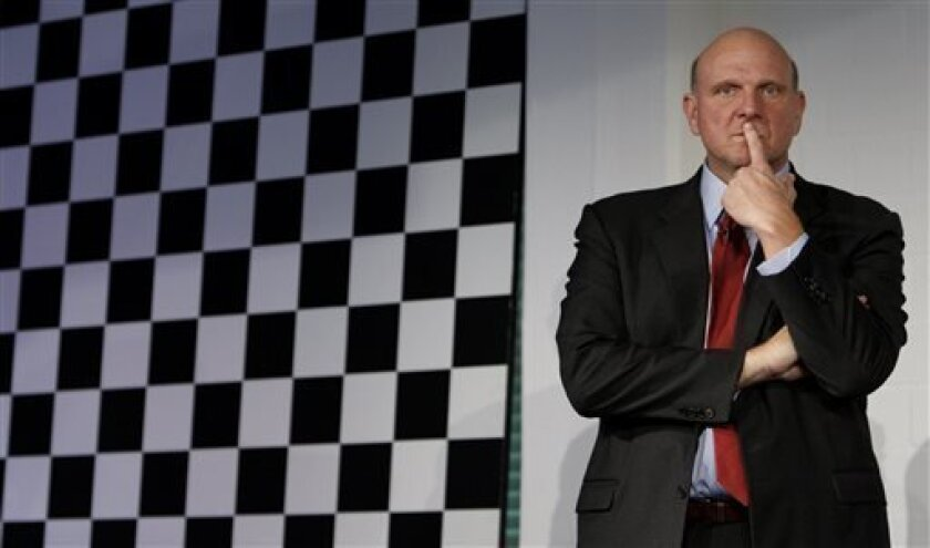 In this Wednesday Oct. 7, 2009, photo, Steve Ballmer, CEO of US computer software company Microsoft, follows a news conference in Munich, southern Germany. Microsoft Corp. announced Thursday, July 11, 2013 it is reshuffling its business in an attempt to promote faster innovation and a sharper focus on devices and services. (AP Photo/Matthias Schrader)