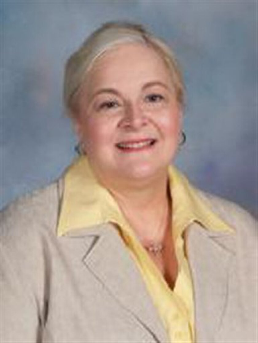 This image provided by the Millard Public Schools shows an undated photo of Millard Vice Principal Vicki Kaspar, 58, who died at a hospital hours after being shot police said. The son of a police detective opened fire at a Nebraska high school Wednesday, Jan. 5, 2011 fatally wounding the assistant principal and forcing panicked students to take cover in the kitchen of the building just as they returned from holiday break. (AP Photo/Millard Public Schools) NO SALES