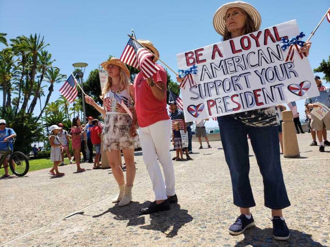 Demonstrators gather at the County Administration Center on the Fourth of July