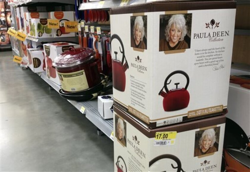 Boxes of Paula Deen tea kettles are displayed in a Little Rock, Ark., Wal-Mart Stores Inc. store Wednesday, Sept.25, 2013. Despite a July, 2013, announcement that it had ended its relationship with the Southern cook, the retailer said Wednesday it expects to keep her branded cookware on the shelves