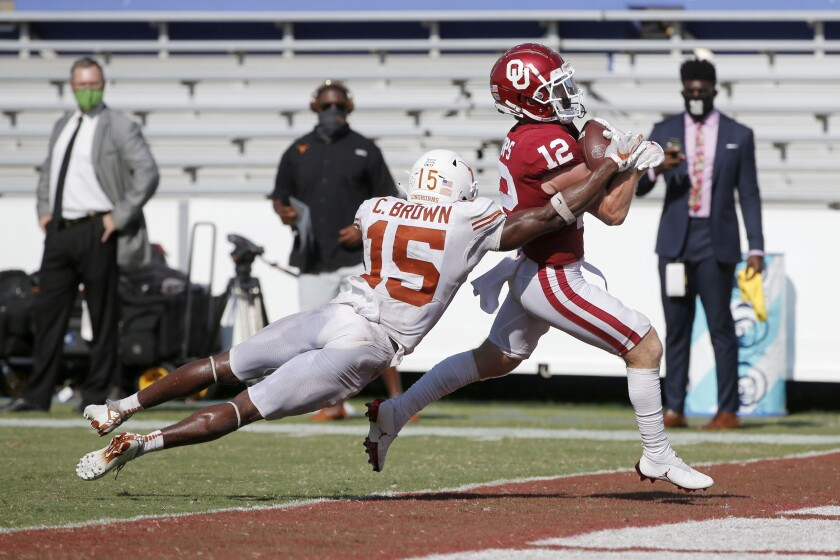 Oklahoma wide receiver Drake Stoops breaks away from Texas defensive back Chris Brown to score the winning touchdown.