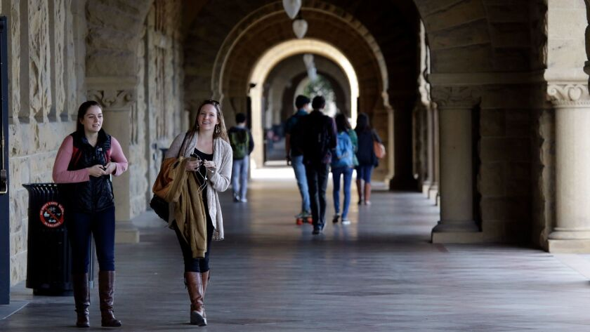 Students walk on campus at Stanford University