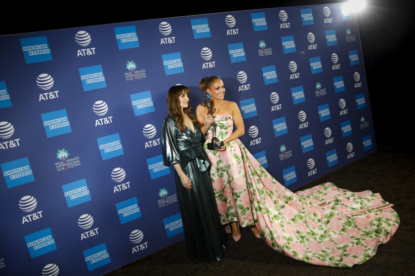 "Director Lorene Scafaria presents an award to Jennifer Lopez for the STX film ""Hustlers."""