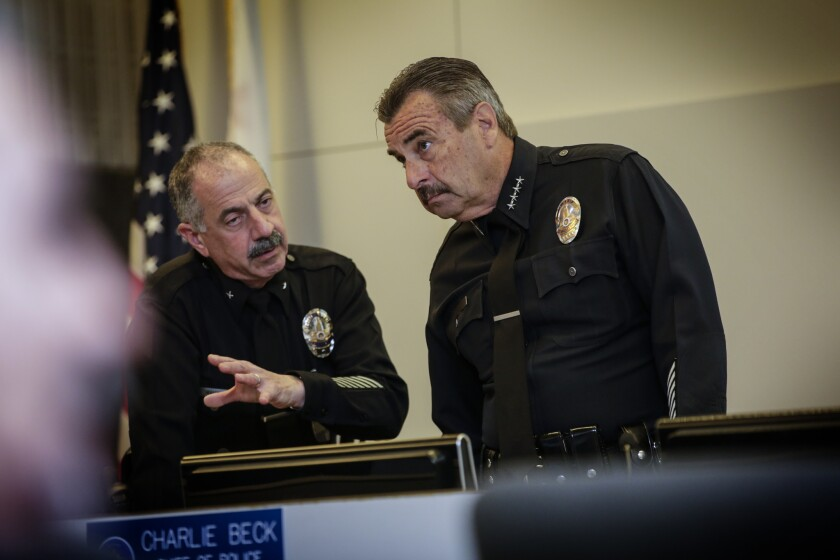 LAPD Cmd. Stuart Maislin of the internal affairs group, left, chats with Chief Charlie Beck before a board of police commissioners meeting on March 1.