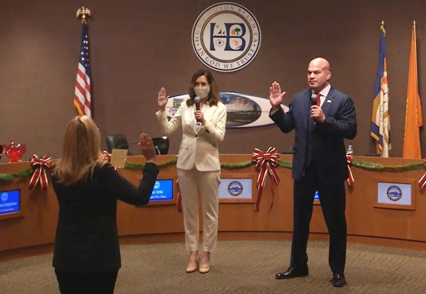 Kim Carr and Tito Ortiz take the oath of office
