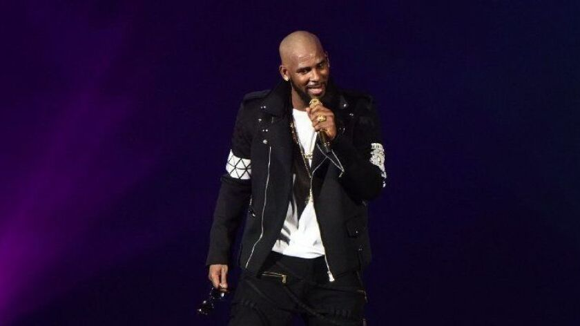 """R&B singer R. Kelly is under mounting scrutiny in the wake of a new documentary, """"Surviving R. Kelly."""""""