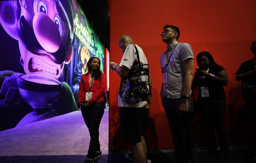 """LOS ANGELES, CA -- JUNE 11, 2019: Attendees wait in line for Nintendo's """"Luigi's Mansion 3"""" during E"""