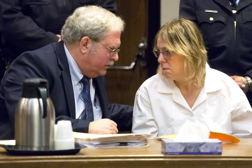 Attorney Steven Johnston, left, confers with Joyce Mitchell, a former prison employee who provided the tools that two murderers used to cut their way out of a maximum-security facility in northern New York, during a restitution hearing at the Clinton County Government Center, Friday, Nov. 6, 2015,