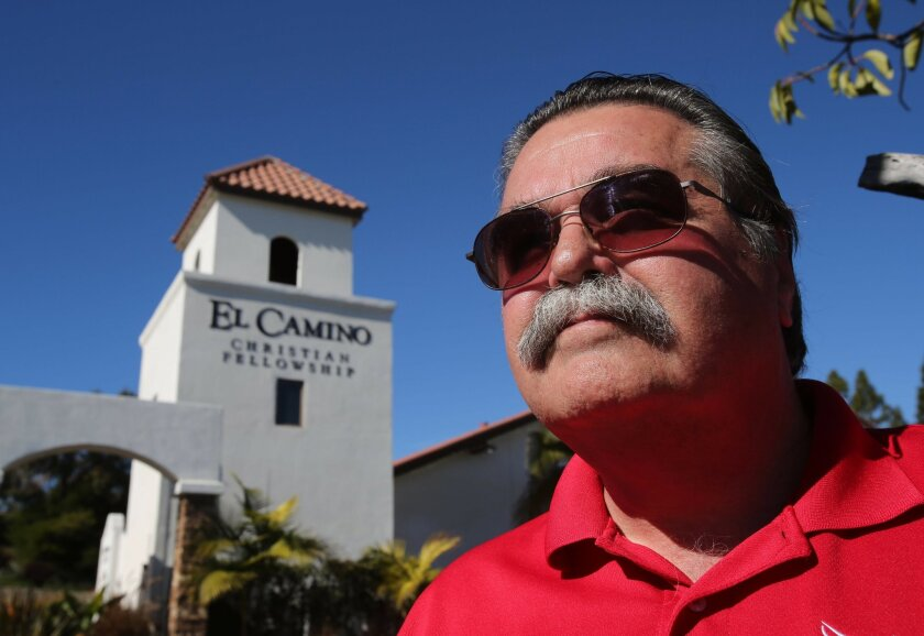 Pastor Larry Peltier of Beach Chapel in Encinita with a bell tower that has cellular antennas located inside. Some parents at the Innovation Centre Encinitas which Julian Charter School runs at the Curch are upset because there are more than a dozen cell phone towers located on the property