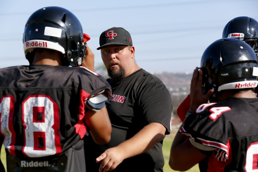 Castle Park coach Chris Livesay works with his players as the Trojans prepare for the season opener against O'Farrell on Aug. 23.
