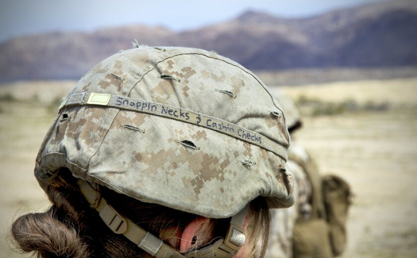 Cpl. Angelique Preston served as an artillery cannoneer in the Ground Combat Element Integrated Task Force. The experimental Marine Corps unit was assessed at Twentynine Palms to determine if women should serve in ground combat units.