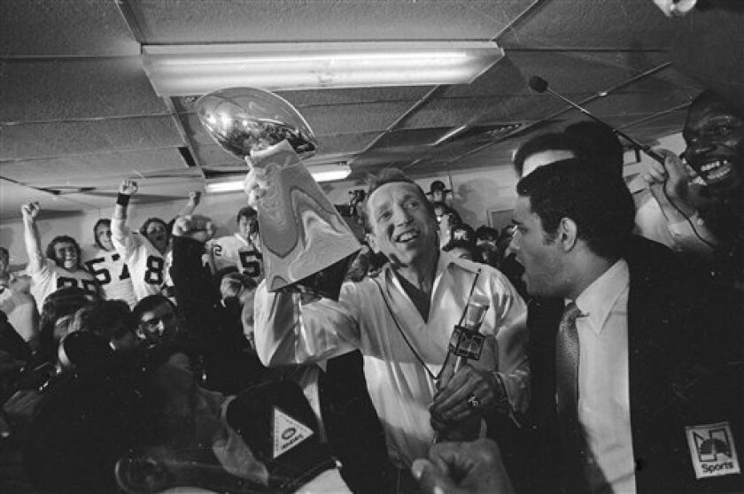 FILE - In this Jan. 26, 1981, file photo, Oakland Raiders general managing partner Al Davis holds up the Vince Lombardi Trophy in the Raiders' locker room after they beat the Philadelphia Eagles, 27-10, in NFL football's Super Bowl XV at the Superdome in New Orleans. Davis, the Hall of Fame owner of the Oakland Raiders known for his rebellious spirit, has died, the team announced on Saturday, Oct. 8, 2011. He was 82. (AP Photo/Paul Sakuma, File)