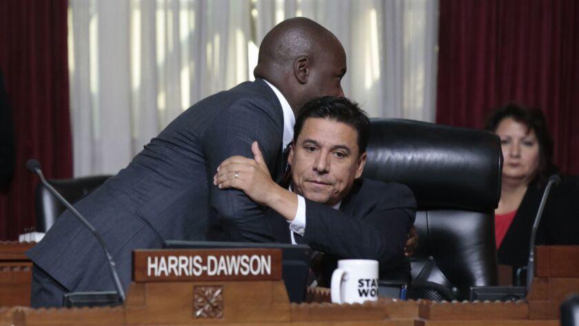 LOS ANGELES, CA-NOVEMBER 20, 2018: LA City Councilman Jose Huizar, right, gets a hug from Councilman