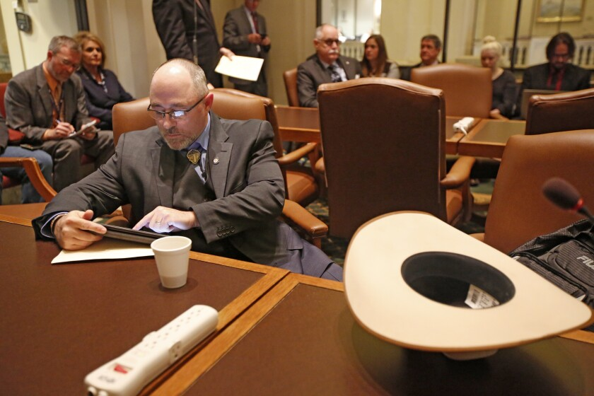 """FILE - In this Feb. 14, 2017, file photo, Oklahoma State Rep. Justin Humphrey prepares to speak at the State Capitol in Oklahoma City. Humphrey, an Oklahoma lawmaker who helped revive an anti-transgender bill is coming under fire for saying transgender people """"have a mental illness."""" Humphrey made the comment in an email exchange with a woman who was urging him to vote against the bill. Humphrey defended his comments in an interview Friday, April 16, 2021, with The Associated Press. (Steve Gooch/The Oklahoman via AP, File)"""