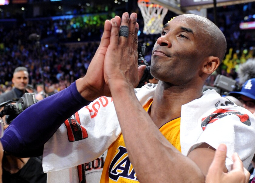 Kobe Bryant, hands together prayer-style, thanks the Staples Center crowd at his final game, April 13, 2016.