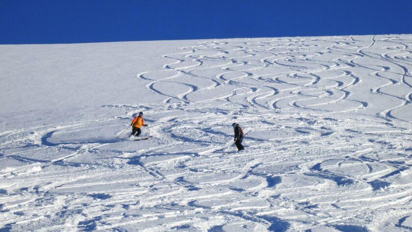 Skiing fresh powder in BC'€™s Cariboo Mountains.