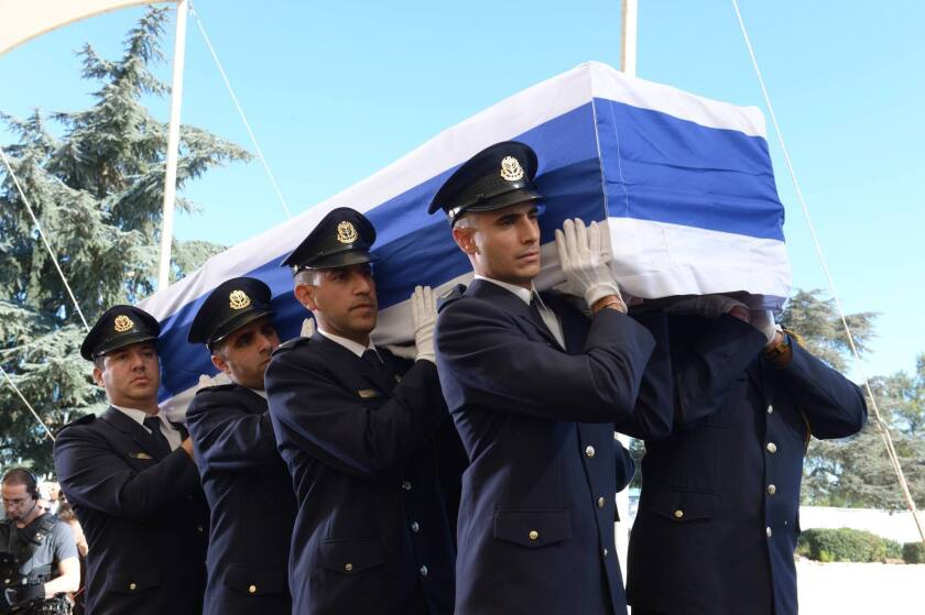 Members of a Knesset guard carry the flag-draped coffin during the funeral of the former Israeli leader Shimon Peres at Mount Herzl Cemetery on Sept. 30, 2016.