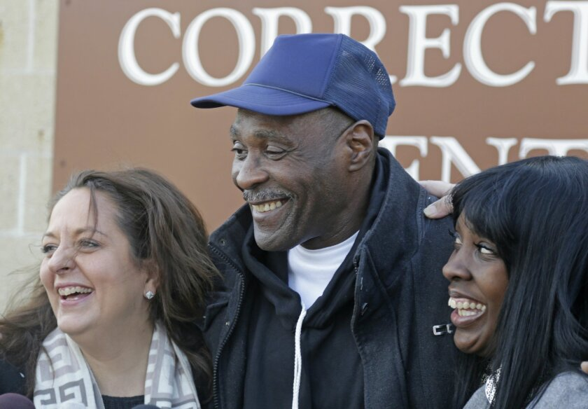 FILE - In this Dec. 11, 2013 file photo, Stanley Wrice, smiles with his attorney Heidi Linn Lambros, left, and daughter, Gail Lewis, as he leaves Pontiac Correctional Center in Pontiac, Ill.  Wrice was released after serving more than 30 years in prison when a Cook County Judge overturned his convi