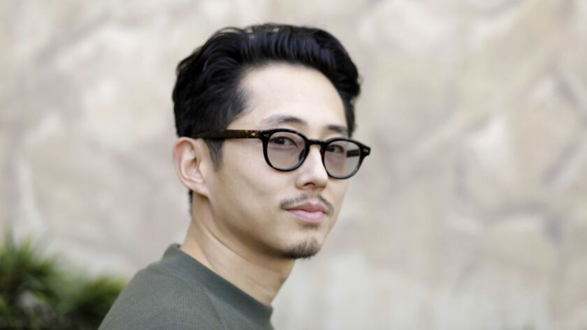 """LOS ANGELES, CA-OCTOBER 23, 2018: Steven Yeun, one of the stars of the upcoming indie """"Burning,"""" is"""