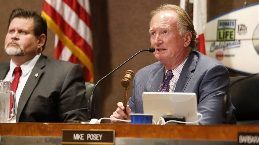 Mayor Mike Posey asks the public for order during public comments regarding Senate Bill 54, or the C