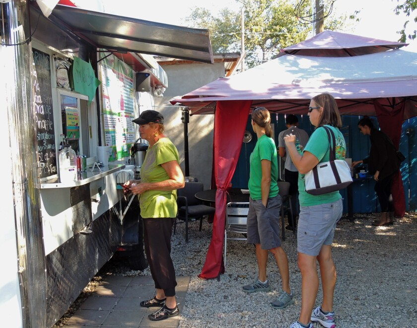 Customers line up in front of Veracruz All Natural, a food truck in Austin, Texas.