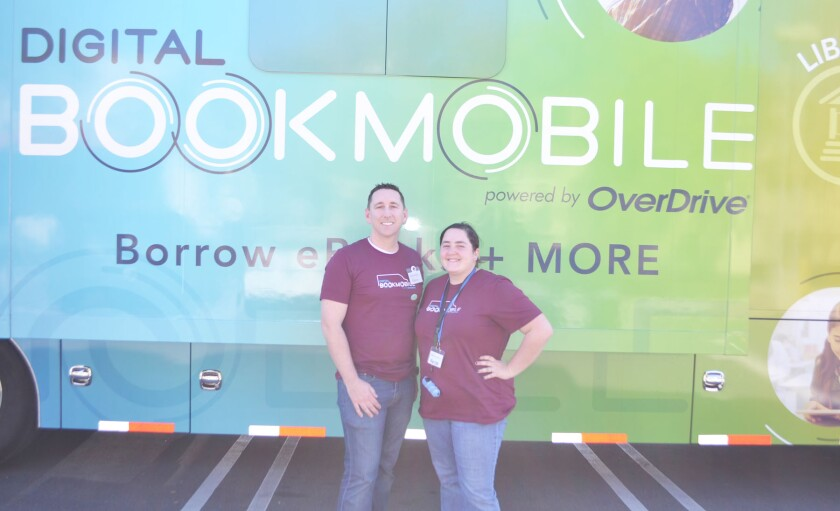 Kevin Coon and Marissa Gillett of the OverDrive Digital Bookmobile made a stop in Poway on Tuesday.