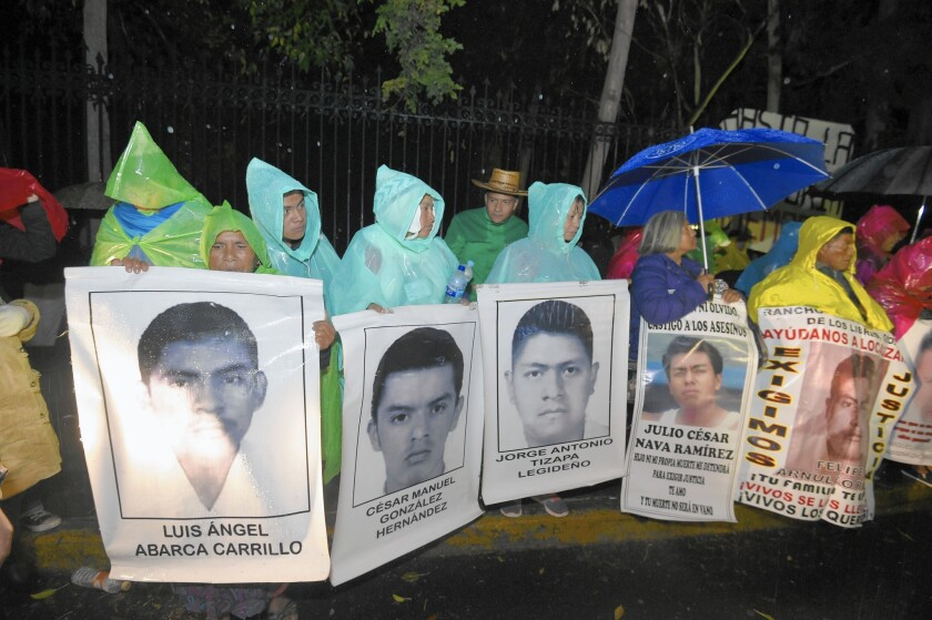 Relatives of the 43 Guerrero state students missing since September protest outside the presidential residence in Mexico City on Christmas Eve.