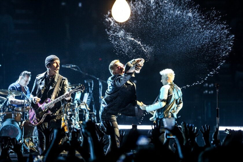 Larry Mullen Jr., from left, the Edge, Bono and Adam Clayton of U2 shown performing at the Innocence + Experience tour at the Forum in Inglewood in May. The Edge and Clayton made a surprise appearance Wednesday in New York with U2 tribute band Unforgettable Fire.