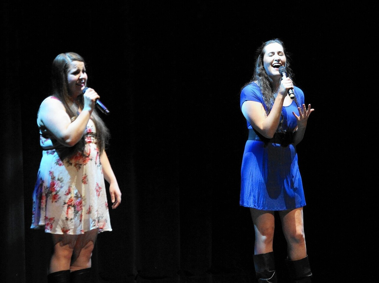 """Vocal duet of Rebecca Fondiler and Sheridan Elmer perform """"What About Love"""" during the benefit for Travis Ammann on Wednesday."""