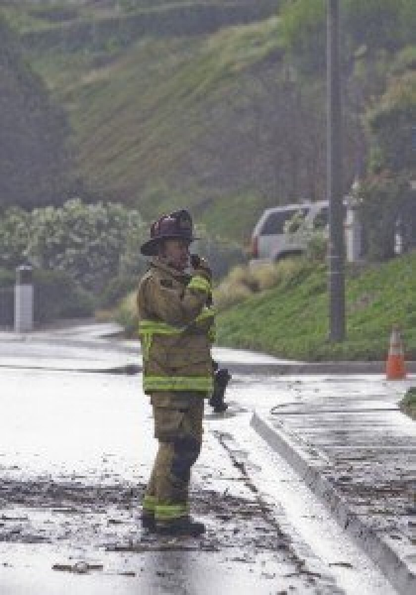 Firefighters responded to a small fire caused by lightning July 27 in Solana Beach.  Photos by Tim Holdsworth