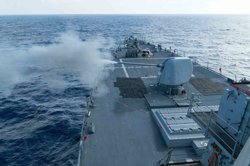 The destroyer Curtis Wilbur conducts a live-fire gunnery exercise with its 5-inch .54-caliber gun on Jan. 15, 2016 in the South China Sea. / photo courtesy of U.S. Navy