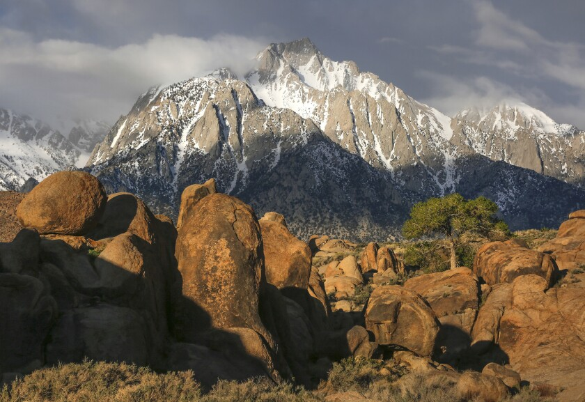 OWENS VALLEY, CALIFORNIA, MARCH 25, 2017: Lone Pine Peak (center) soars above the prehistoric rocks