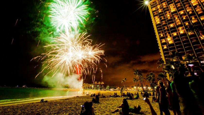 Fireworks explode each Friday evening beside the Hilton Hawaiian Village on Waikiki Beach.