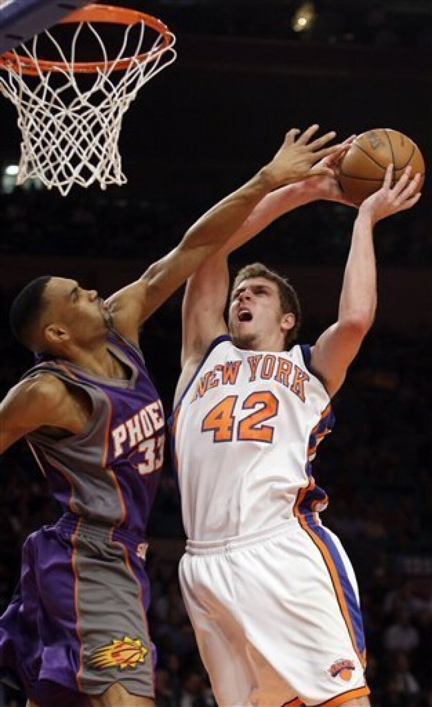 New York Knicks' David Lee (42) shoots over Phoenix Suns' Grant Hill (33) during the first half of an NBA basketball game Tuesday, Dec. 1, 2009 in New York. ( AP Photo/Frank Franklin II)